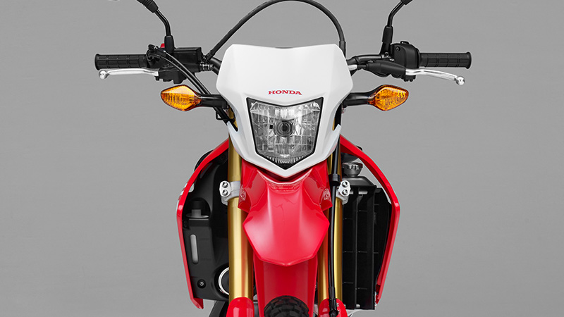 The CRF250 Rally comes finished in Honda's Extreme Red competition colour – just like the desert racing 450 – as a base, with black and white accents inspired by the HRC factory machines.
